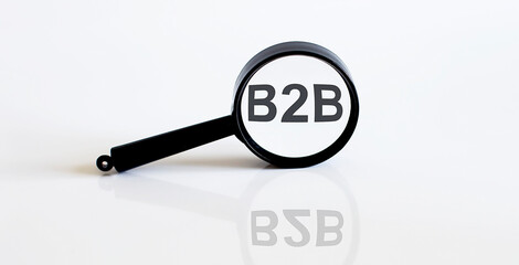 Magnifier with text B2B on the white background