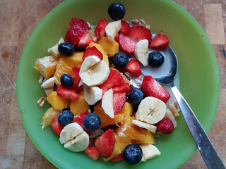 tasty oat meal with various fruit pieces for breakfast