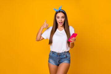 Astonished surprised girl promoter use smartphone show thumb up sign recommend incredible ads...