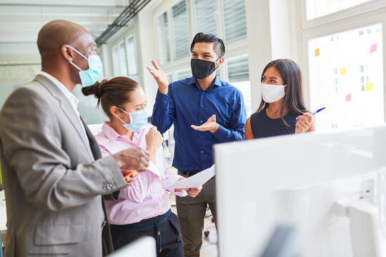 Start-up team of an internet agency with face mask