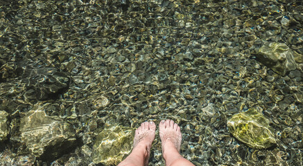 women Feet on in river
