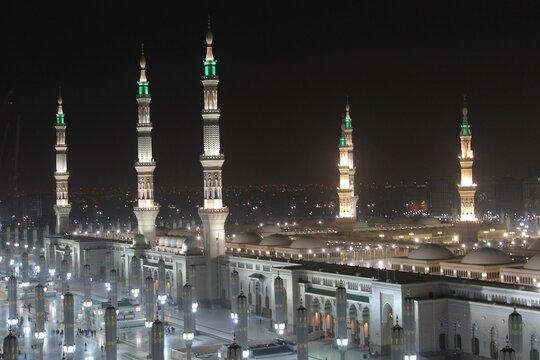 Moon between two towers of the Prophet's Mosque in Al Madinah, Saudi Arabia