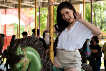 Foto op Plexiglas Amusementspark amusement, amusement park, around, asian, beautiful, beauty, carnival, carousel, cheerful, classic, classic ride, enjoy, entertainment, female, festival, fun, fun time, funfair, garden, girl, go, go a