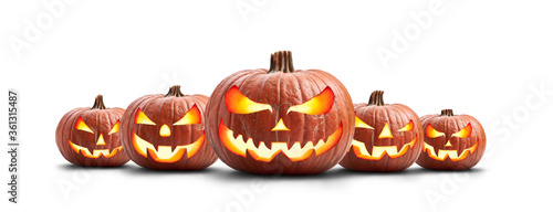 A group of five lit spooky halloween pumpkins, Jack O Lantern with evil face and eyes isolated against a white background.