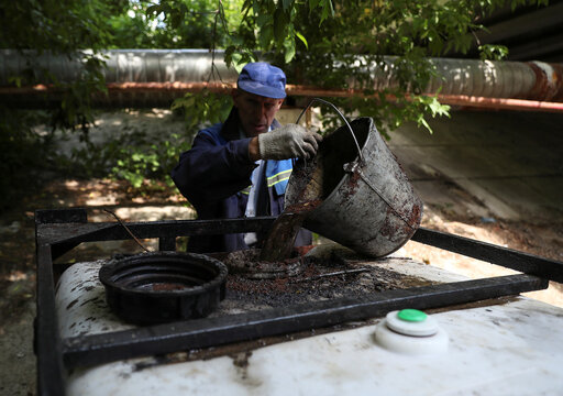 Specialists take part in recovery works following an oil spill in Moscow Region