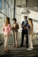 Group of asian business people meeting and working in office and wear mask for protect prevent infection by corona virus