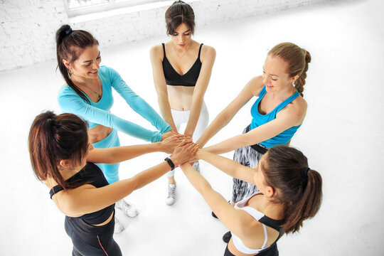 A team of girls doing sports in the gym. The concept of sports, healthy lifestyle, fitness, stretching