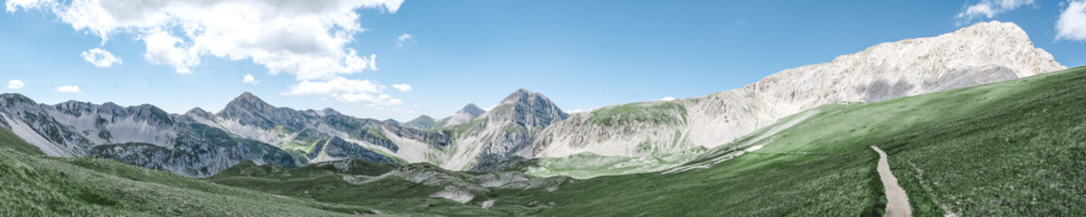panoramic view of the Appennini Gran Sasso in meadow from Campo Imperatore in Italy landscape format