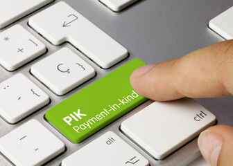 PIK Payment-in-kind - Inscription on Green Keyboard Key.