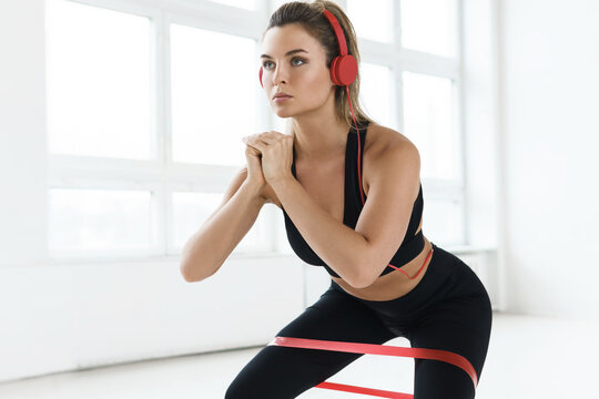 Young  woman during her workout with a loop resistance band