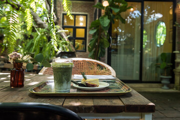Matcha green tea and cheesecake in coffee garden