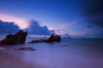 Motion seascape with stone arch at dawn