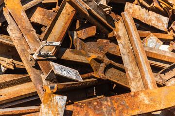 Rusted railroad tracks at a scrap yard