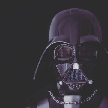 BLOOMFIELD NJ: JAN 10, 2016: Toned Portrait of Darth Vader mask and helmet on a black background.  Darth Vader is a Sith Lord also known as Anakin Skywalker, and is father to Luke Skywalker