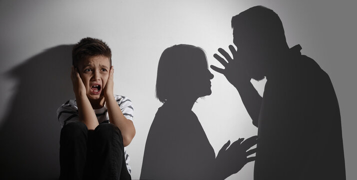 Scared little boy closing his ears and silhouettes of arguing parents. Banner design