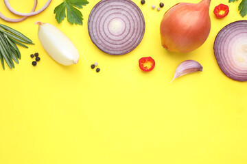 Fototapete - Flat lay composition with onion and spices on yellow background. Space for text