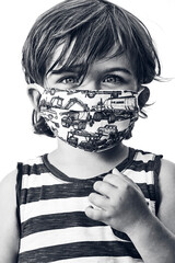 young boy wearing a striped shirt and a mask on a white background in black and white, vertical close up