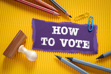 HOW TO VOTE concept. Text on torn, purple paper