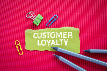 CUSTOMER LOYALTY concept. Text on torn, gren paper