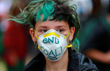 An activist attends a protest in front of Social Democratic Party (SPD) headquarters for immediate phase out of hard coal-powered plants in Berlin