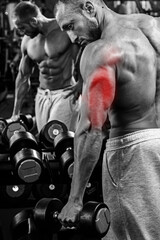 Triceps specialization in bodybuilding. Man during workout in the gym