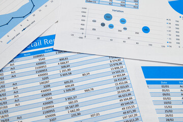 business office desk closeup - financial reports, analysis and accounting, set of documents, tables...