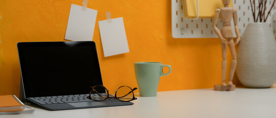 Wall Mural - Stylish workspace with digital tablet, glasses, mug and decorations on white desk