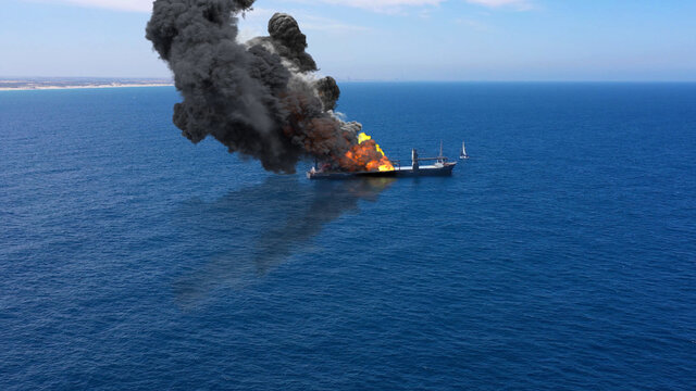 Cargo ship burning on fire with large scale smoke-Aerial Aerial, Mediterranean Sea, Cargo tanker ship, Real Drone view with visual effect Elements