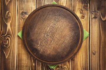 pizza cutting board or tray at wooden background