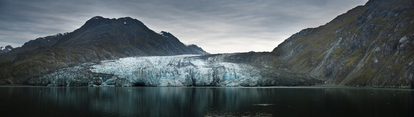 Panoramic shot of Alaskan glaciers on a gloomy day