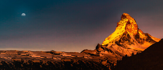 Panoramic mountain landscape with views of the Matterhorn peak in Pennine alps during sunrise, Switzerland.