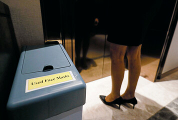 A bin for used masks is seen near elevators at the Shangri-La hotel, in Colombo