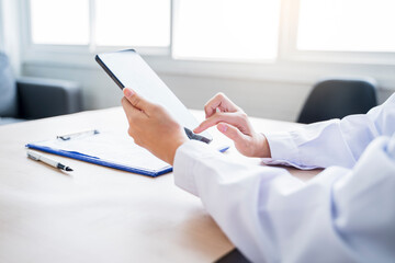 Medical healthcare clinic Asian hand using smart tablet device technology diagnosing patient...