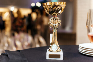 Gold cup on a banquet table horizontal
