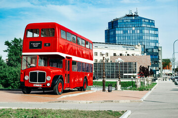 Poster London red bus Landscape of a modern architectural building with a red bus
