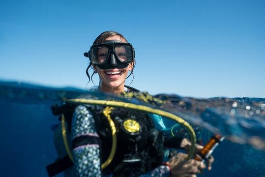 Woman SCUBA Diving Smiling in Ocean