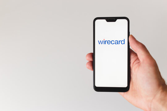 Minsk, Belarus- June 18 2020: smartphone with wirecard logo on the screen. hand touching the screen.