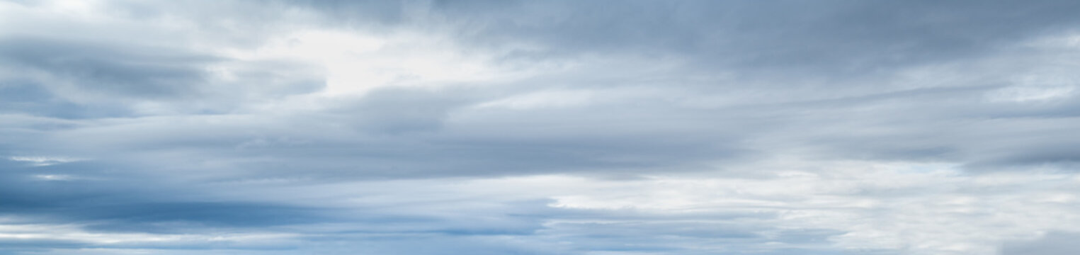 Clouds in the overcast sky view. Climate, environment and weather concept sky background.