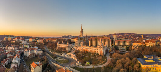 Fototapeten Budapest Panoramic aerial drone shot of Matthias churh on buda hill during Budapest sunrise