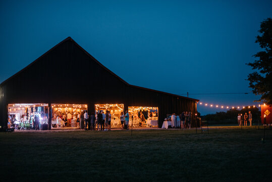 Night view of a party in a barn