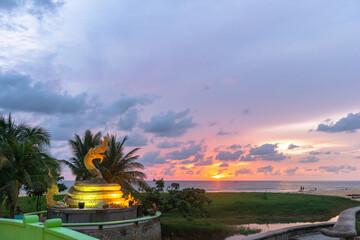 .beautiful sunset behind the great Naga statue in Karon beach Phuket Thailand