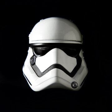 NEW YORK USA - JULY 12 2016: Portrait of a Star Wars The First Order Stormtrooper helmet on a black background with dramatic lighting