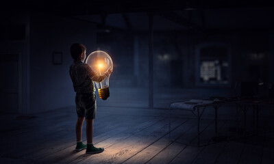 Boy with a light bulb