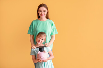 Little girl and her mother with savings for education on color background