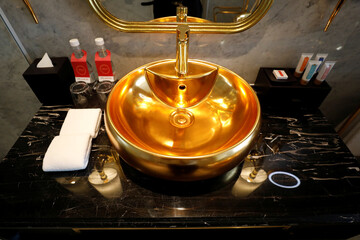 A gold plated bathroom sink is seen in the newly-inaugurated Dolce Hanoi Golden Lake luxury hotel, after the government eased a nationwide lockdown following the global outbreak of the coronavirus disease (COVID-19), in Hanoi