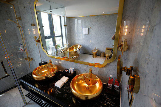 Gold plated bathroom sinks are seen in the newly-inaugurated Dolce Hanoi Golden Lake luxury hotel, after the government eased a nationwide lockdown following the global outbreak of the coronavirus disease (COVID-19), in Hanoi