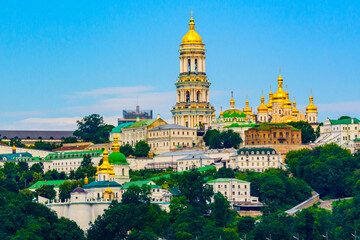 View on buildings of the Kiev Pechersk Lavra and Great bell tower from left bank of river Dnieper in Kiev, Ukraine