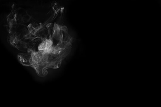 White smoke isolated on black background. smoke stock image