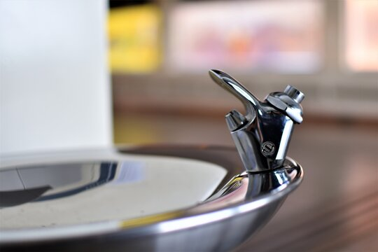 The tap and basin of a drinking fountain or water fountain normally found in airports and train stations