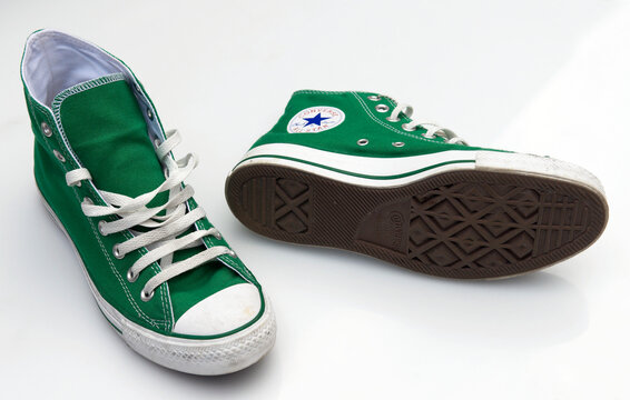 London, England - July 27, 2007: Pair of Converse Baseball Boots in worn condition, Converse is an American shoe company founded in 1908